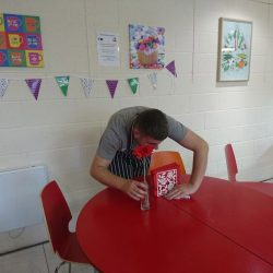 young person cleaning table