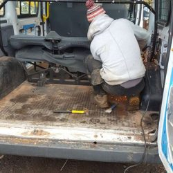 construction in a van with angle grinder