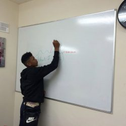 young person doing a diagram on a whiteboard